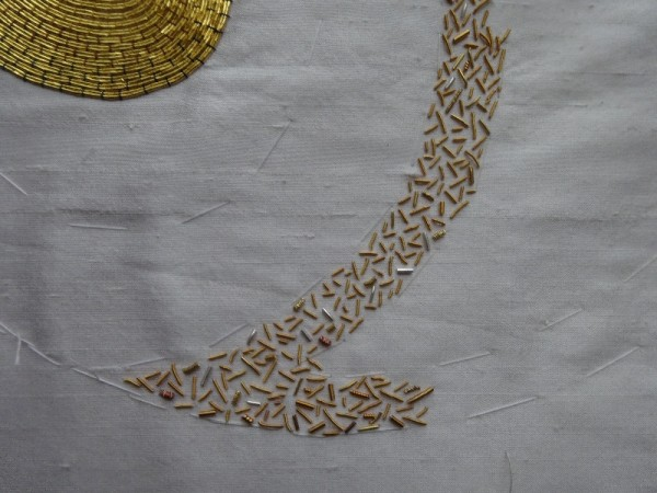 Goldwork sampler showing gold thread cut and used as beads
