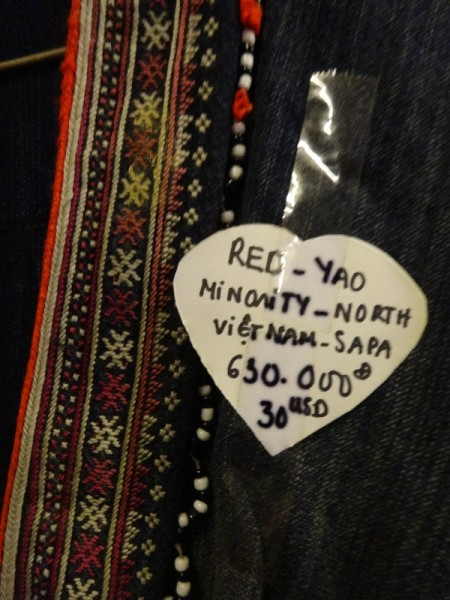 Red Dao/Yao vintage jacket  with embroidery. Photographed in  an 'antique' shop in Saigon  round the corner from our hotel. Wouldn't you know it the woman in the shop greeted daughter No 2 enthusiastically , remembering she'd visited the shop before (and undoubtedly brought something). You travel half way round the world ...well better being known in an antique shop than in a bar...)
