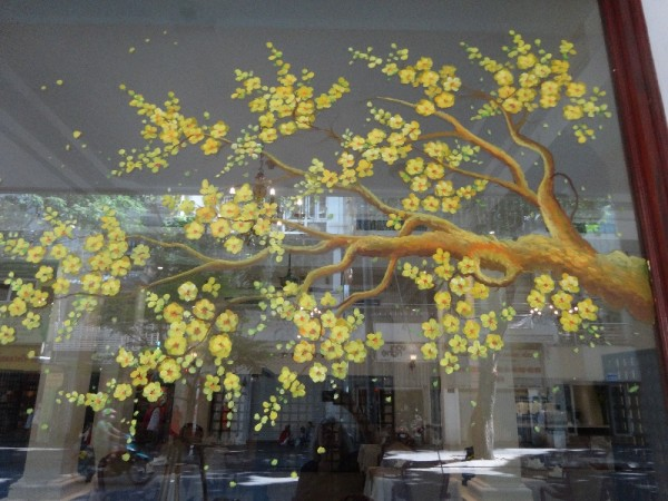 Shop window in Saigon (Ho Chi Minh City) with Tet decorations - a painted apricot branch