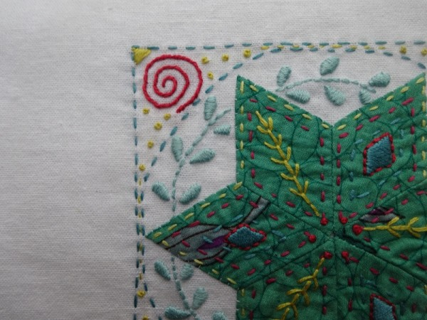 Embellished patchwork star : detail (hand embroidered by Mary Addison)